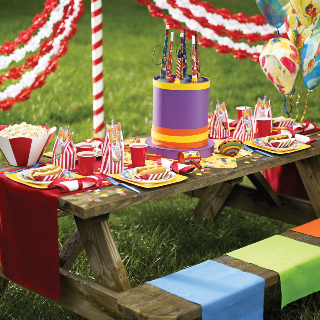 Picnic table with circus clowns on balloons plates and decorations