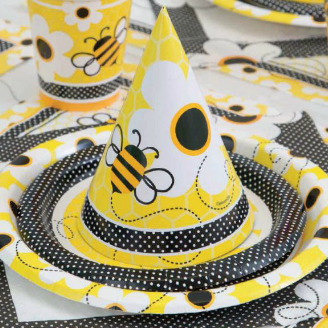 yellow and black bumble bee and daisy party hats plates cups and table cloth with polka dots