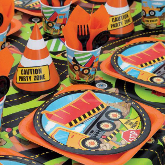 dump truck and caution signs on plates and hats