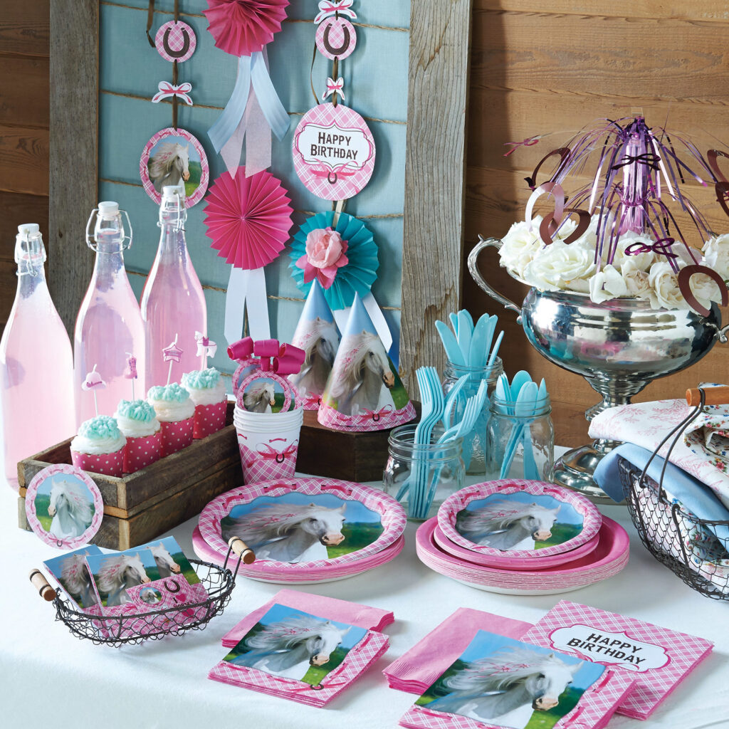 Pastel colors with horses and gingham on plates napkins and decorations - happy birthday message