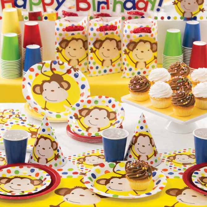 monkey on yellow background and multicolored polka dots on plates napkins and tablecloths