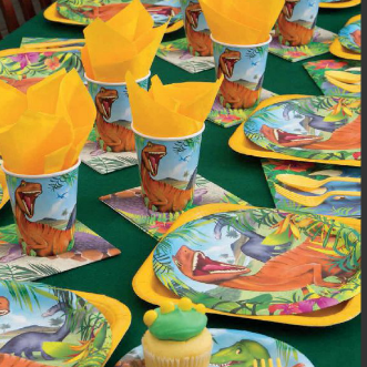 Dinosaurs on plates and cups with yellow napkins
