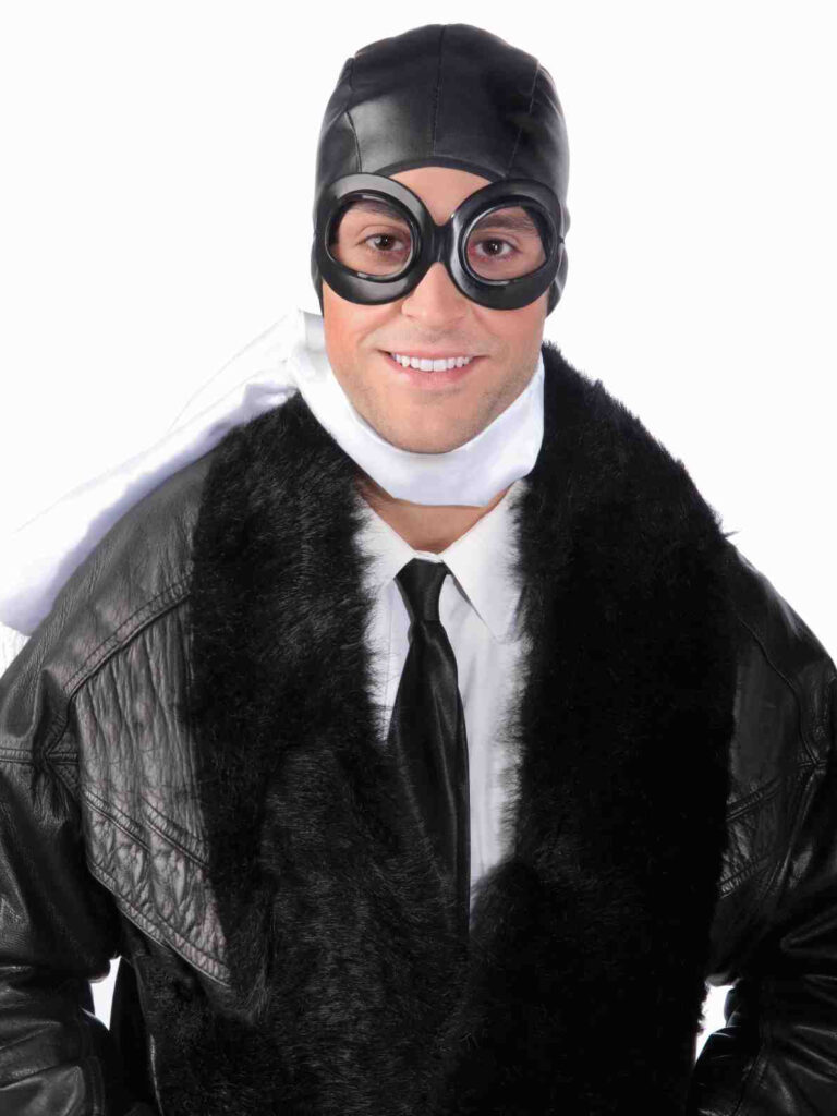 Adult Male in aviator outfit with goggles cap and scarf