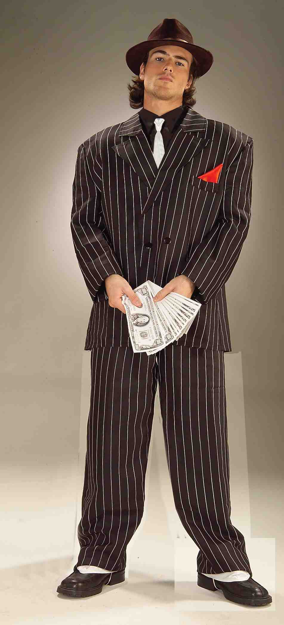 adult male in gangster pinstripe suit with hat shoes and money for accessories
