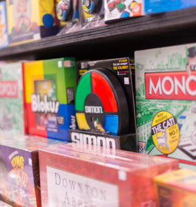 Old games electronic Simon Monopoly Blokus on shelves
