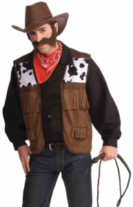 adult male in cowboy vest with cow print and fringes bandana hat and fake mustache and beard with whip