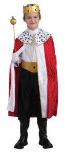 little boy in king costume with robe boots scepter and crown in red