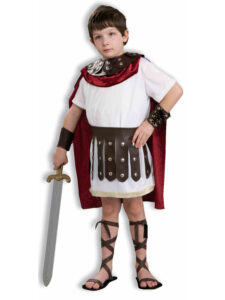 little boy in julius caesar costume with sword and knee high sandals