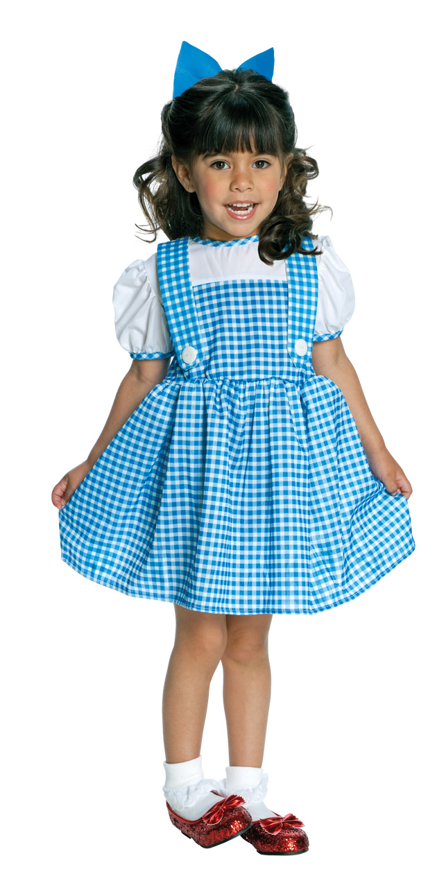 little girl wearing dorothy from wizard of oz dress and ruby red slippers and blue bow in her hair