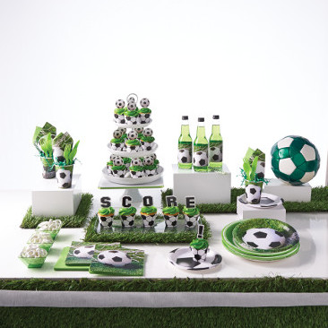 soccer balls on plates cups bottle labes and napkins